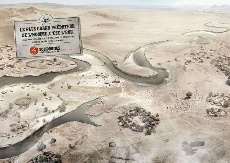 solidarites-internationales-publicité-affiche-eau-potable-serpent-prédateur-fleuve-village-agence-bddp-fils